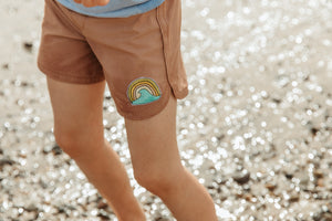 Seaesta Surf kids boardshorts are earth and performance conscious, featuring eco-friendly fabrics and our signature vintage-inspired boardshort design with a scalloped retro boardshort hem. This is a special collaboration with Surfy Birdy.