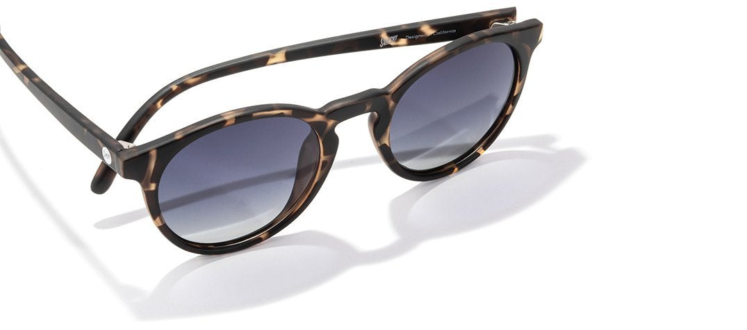Polarized sunglasses made from recycled resin in a tortoise shell color.
