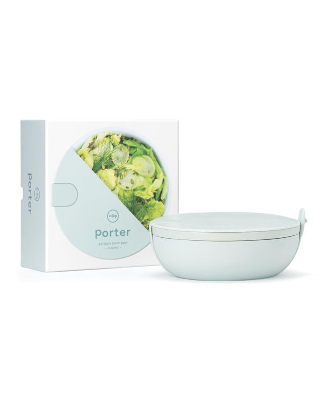 The Porter Bowl is a premium ceramic lunch bowl that features a protective silicone wrap, rigid plastic lid and snap-tight silicone strap. Perfect for transporting your salad, grain bowl or leftovers - wherever life may take you.