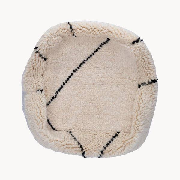 Handmade pouf made in partnership with artisans in Morocco out of hand-knotted pile rugs. Wool rugs have been repurposed and given new life. Each pouf is slightly different, even when cut from the same rug. The rugs are first professionally cleaned, and then cut and sewn into a floor cushion, with a strong zipper and neutral canvas bottom.