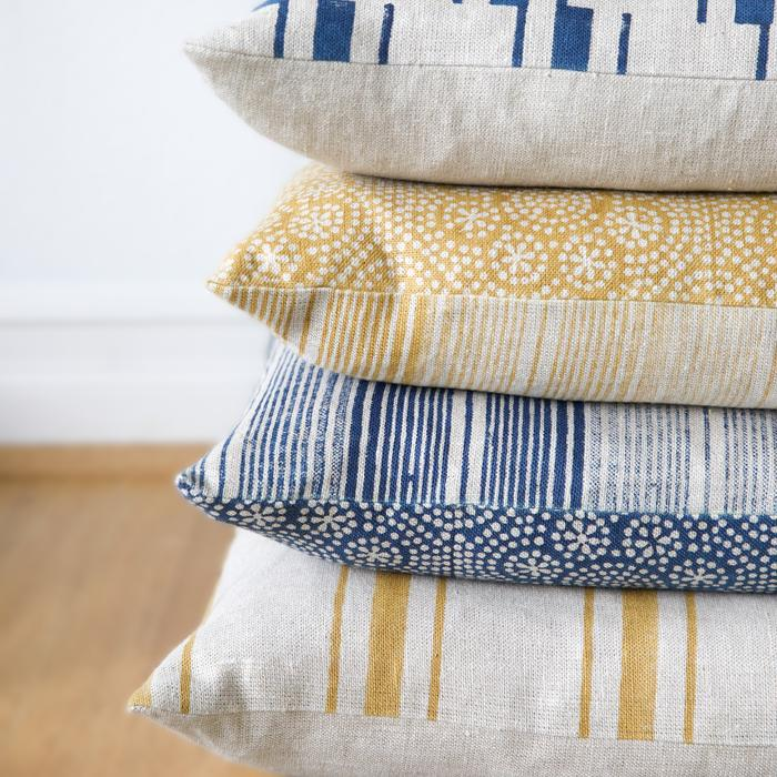 "18"" square hand block-printed, 100% linen pillow. Featuring an offset striped pattern in mustard. Zipper closure, solid linen back. Includes down feather insert."