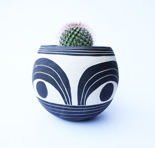 "Handmade carved orb planter made in Portland. Black matte interior. Hand-carved matte exterior. Includes handmade tray to fit any 6"" or 8"" planter."