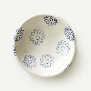 A small ceramic dish perfect for holding jewelry, keys, incense, spices, or sauces. Handmade in Los Angeles, CA, featuring a hand-painted cobalt blue, flower pattern.