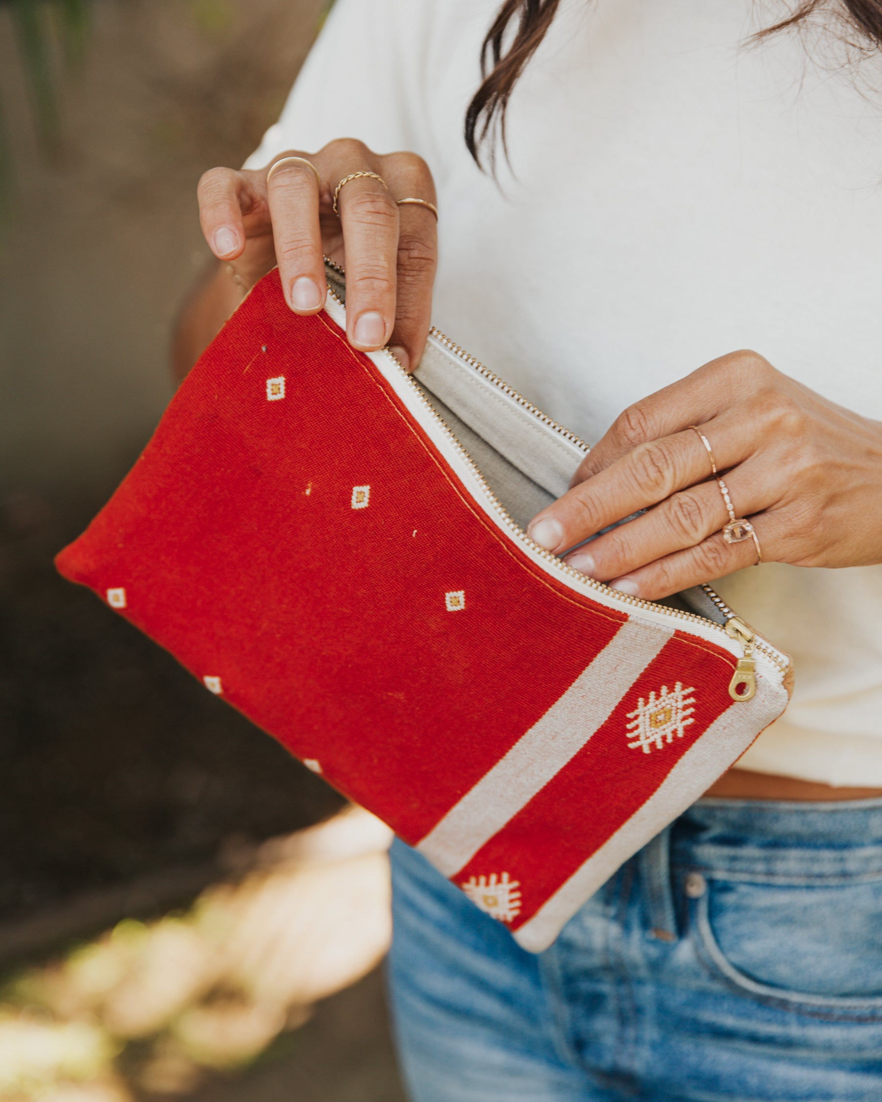 This handmade zippered pouch features hand-woven, naturally-dyed and fair trade textiles from a cooperative in Chiapas, Mexico. It is sewn by a resettled refugee paid above a living wage in San Diego, California.