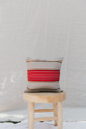 "This handmade 15"" square pillow features hand-woven, naturally-dyed and fair trade textiles from a cooperative in Chiapas, Mexico. It is sewn by a resettled refugee paid above a living wage in San Diego, California."