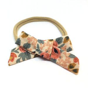 Dainty hair bow for kids in coral floral
