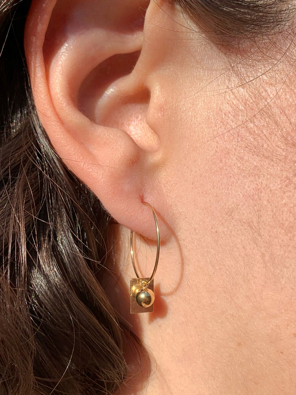 Handmade gold hoops. Two dimensions come together delicately for these everyday hoops.