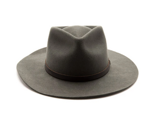 Sustainably made with salvaged and recycled materials. This felt fedora hat has a stiff fit that is sure to break in like a beauty. It sports a wide raw edge stiff brim, tear drop crown, and leather trim.
