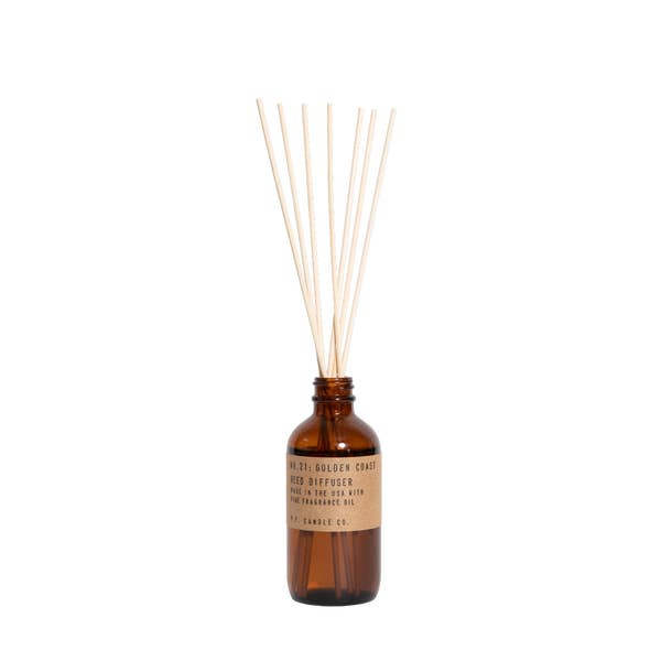Golden Coast reed diffuser by P.F. Candle. Just set it and forget it for low- maintenance, flameless scent. Golden Coast. Big Sur magic, wild sage baking in the sun, the rumble of waves and rocks. Notes of eucalyptus, sea salt, redwood, and palo santo.