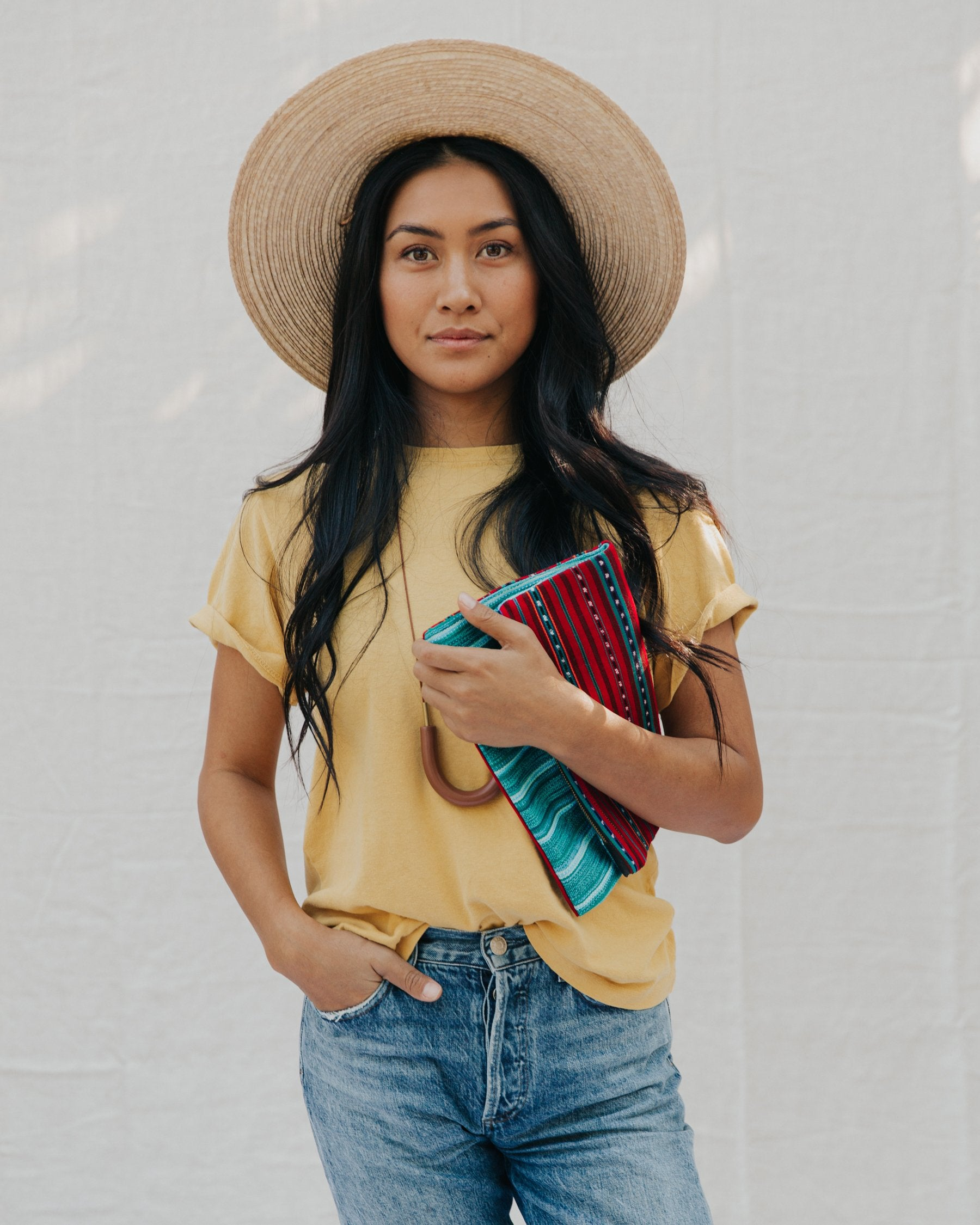 Handmade foldover/reversible clutch featuring fair trade textiles from Mayan artisan cooperatives in Guatemala, 100% organic cotton zippers, sustainably-harvested cork accents and tassels upcycled from textile scrap. Handmade by our resettled refugee artisan, Lashta, locally in San Diego.