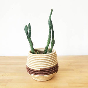 Open image in slideshow, Handmade, woven basket planters made by artisans in Gitarama, Rwanda. The women hand-dye and weave the fibers into these beautiful works of art. The sisal is woven around sweetgrass, a fragrant grass with a subtle sweetness. Use these African baskets as a desk accessory, a plant holder, or to brighten up a shelf.