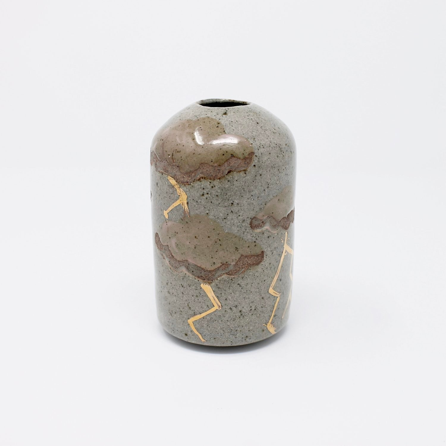 Handmade by Jessica Truelyt in Pasadena, California. Wheelthrown stoneware bud vase with speckle glaze, handpainted pink clouds, and precious metal gold luster accents.