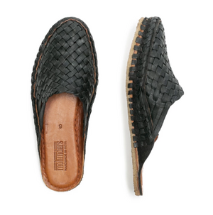 Handwoven black leather slides by Mohinders Shoes made in India in an ethical environment. Every pair is dyed by hand in a simple process using water + iron.