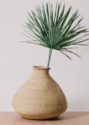 Oversized grass bud vase handwoven in Ghana that makes a stunning statement piece. Intricately crafted in the Bolgatanga region of Ghana. Style it in any space or room in your home, style it as a planter, with large dried florals or alone as shelf decor.