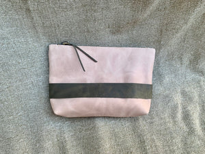 Open image in slideshow, This handmade leather clutch has been hand cut from a soft yet sturdy 5 oz. oil hide leather with an attached hand strap for extra security during an evening out.