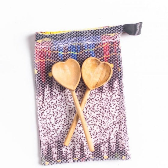 Handmade pair of hand-carved teaspoons made ethically by artisans in Kenya. Each spoon is crafted in rural Kenya from sustainably sourced olive wood
