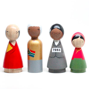 Handmade, classic wooden peg dolls hand-painted with USA-made non-toxic water-based paints. These dolls are hand-chiseled from sustainably-harvested, Urapan wood in Bogota, Colombia. The Peace Makers set includes artistic representations of The Dalai Lama, Nelson Mandela, Rosa Parks, and Malala.