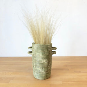 Open image in slideshow, Handwoven prairie grass vases handmade by artisans in Gitarama, Rwanda. Locally grown sweetgrass and marsh grass are used to create these vessels perfect for holding your favorite dried flowers or grasses