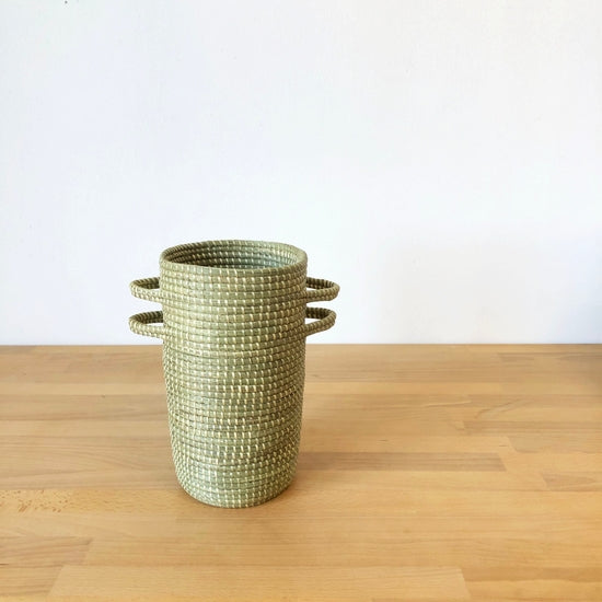 Handwoven prairie grass vases handmade by artisans in Gitarama, Rwanda. Locally grown sweetgrass and marsh grass are used to create these vessels perfect for holding your favorite dried flowers or grasses