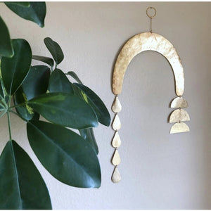 Handmade and artisan-crafted wall hanging made from hand-cut and hammered brass sheet and tubing.