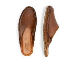 Handcrafted, oiled leather slides from Northern Karnataka, India, by Mohinders. Each pair is made by master shoemakers using full-grain water buffalo leather that molds to your feet over time for the perfect fit. Hand-oiled with a blend of plant-based oils, beeswax, and propolis