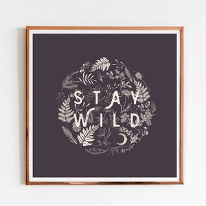 "Black and white minimal ""Stay Wild"" art print with floral background."
