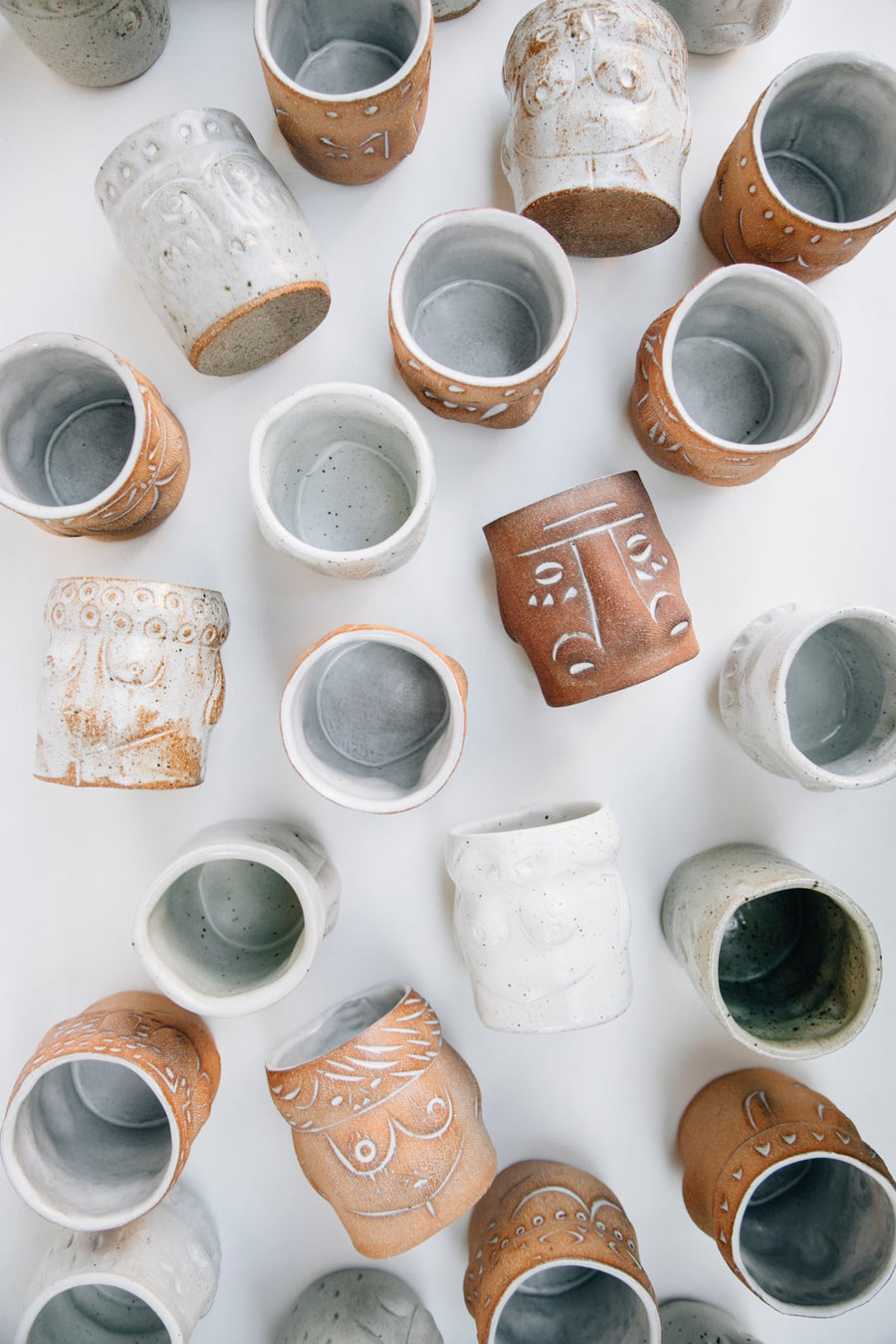 Handmade ceramic tiki cups made in Los Angeles. Each is entirely one of a kind. A collection of Tiki gods were created: each completely unique and handmade, ready to brighten a home or hold a favorite cocktail.