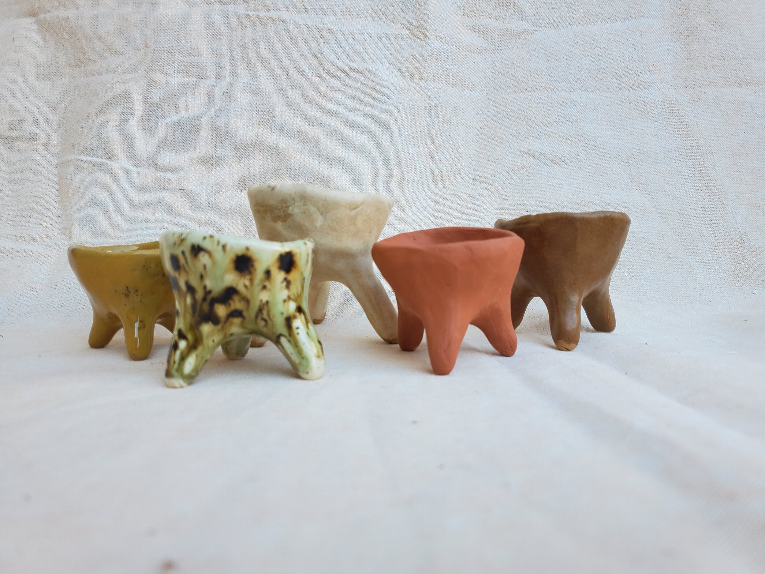 "Handmade clay pinch pots and art objects with lots of character and soul. Each one is totally unique, but measure approximately the same size (about 2"" by 2""). Perfect to use as jewelry or ring dishes, salt pinch, air plant holder, or incense holder."
