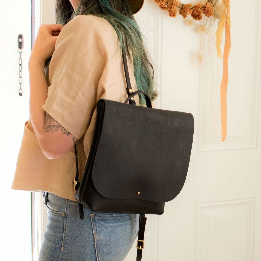 A classic hands free backpack in a small yet roomy size.  Handmade from oil hide leather.  Oil tan hides have been treated with a mixture of oil and wax during the tanning process. It is a truly rugged and durable leather. This bag will age beautifully with time and wear. Throw your daily essentials in and you're ready for the day.