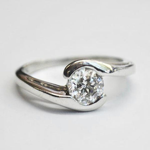 Platinum Bypass Solitaire Ring