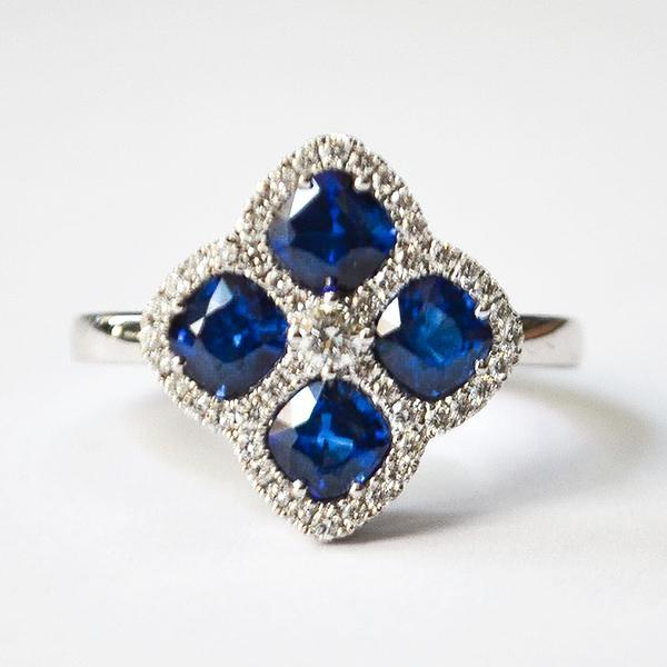 White Diamond & Blue Sapphire 4 Stone Off-Set Halo Ring