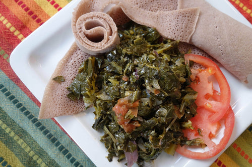 Eritrean & Ethiopian Cuisine Hamli (Sauteed Collard Greens) with Injera Bread - Foodhini