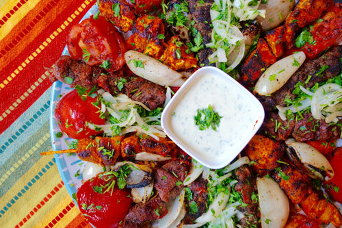 Mashawi (Grilled Kebabs Platter) with Tahini Sauce & Red Pepper Flatbread