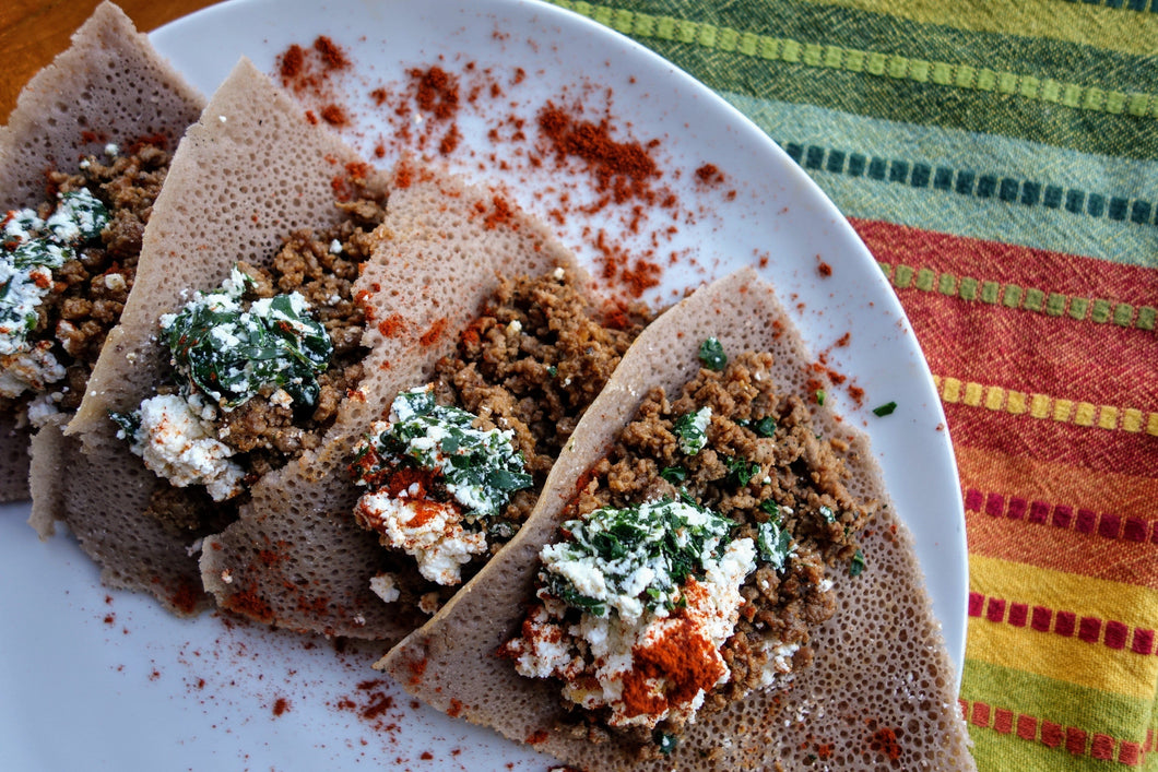 Sautéed Kitfo (Marinated Buttered Beef) with Injera Bread