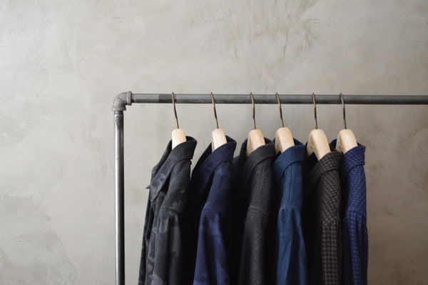 Six luxury menswear shirts made in America by Norman Russell hanging from an industrial clothes rack, made