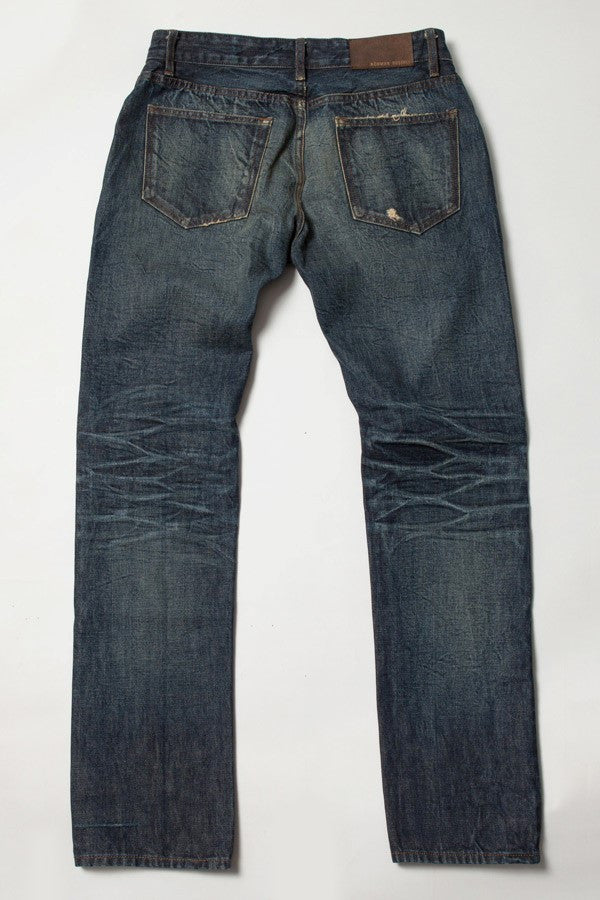 Rear view of the Cookie Slim distressed blue jean made in America by Norman Russell