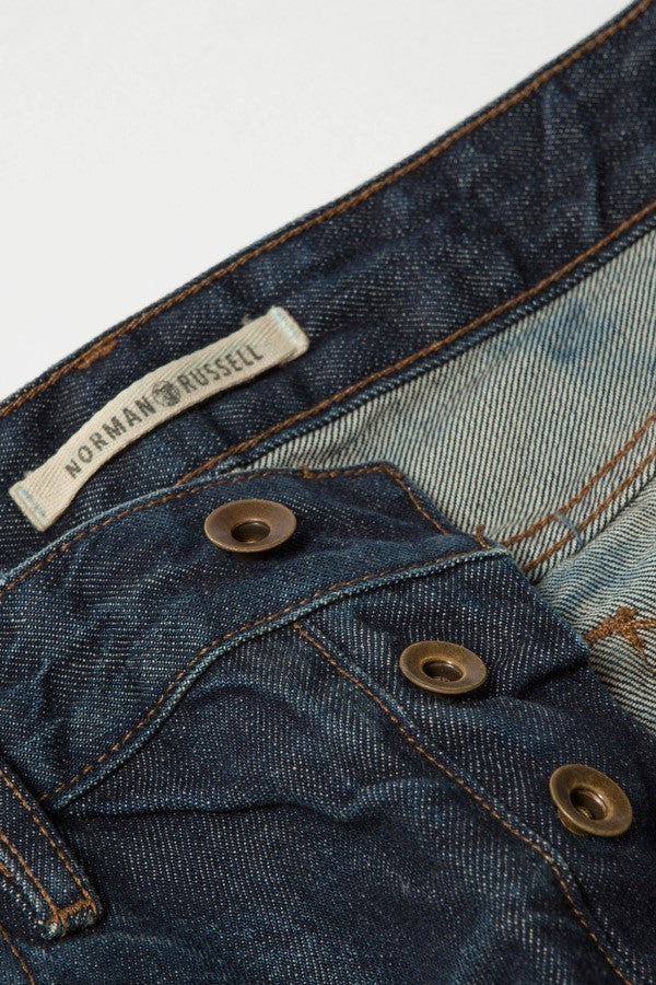 Detail of the button fly on the Cookie Slim blue distressed jean by Norman Russell