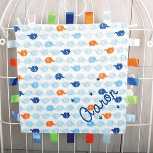 Elephant Print Baby Tag Comforter with Baby's Name embroidered in the corner in blue