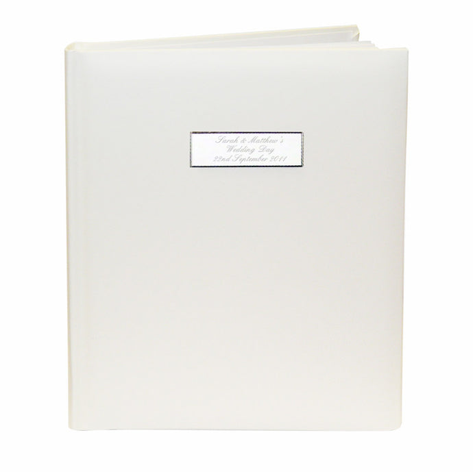 Personalised wedding album with silver plaque