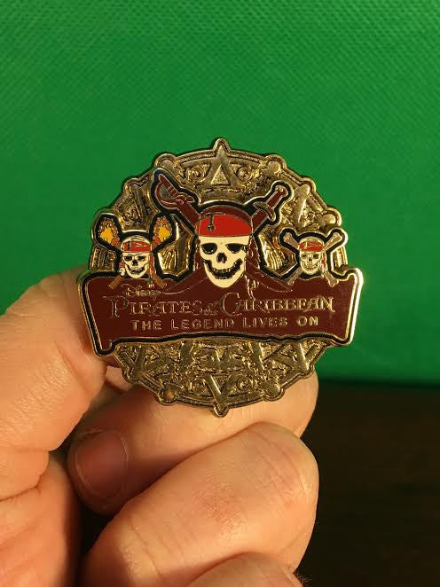 WALT DISNEY -- OFFICIAL PIRATES OF THE CARIBBEAN THE LEGEND LIVES ON SKELETON SKULL COIN TRADING PIN 59576
