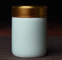 Glazed Ceramic Tea Caddy with Anodized Aluminun Screw Top.