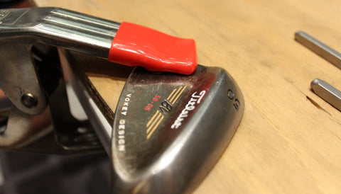 Secure your golf club to the table with the golf club clamp