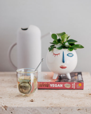 Red Raspberry Leaf Tea by Vyne Health on Ellie bullen elsa's wholesome life vegan cookbook the global vegan with vase and a brewed glass of tea for pregnancy support