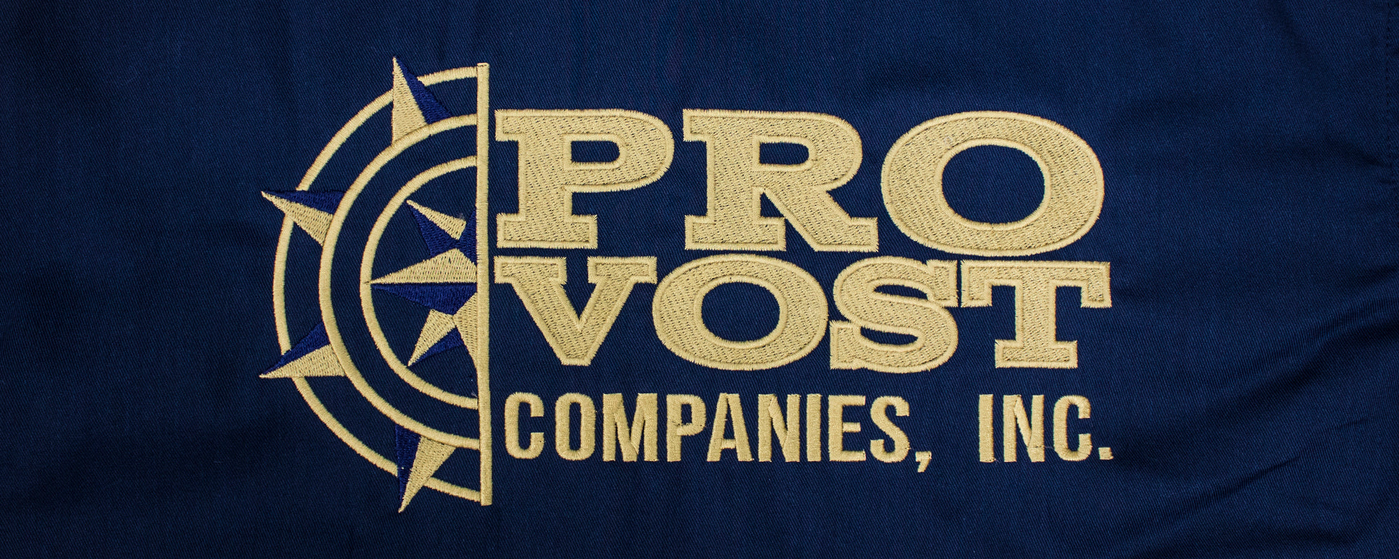 Example of ass kickin' embroidery of the PROVOST COMPANIES, INC. logo stitched by strange planet printing of Brockton MA