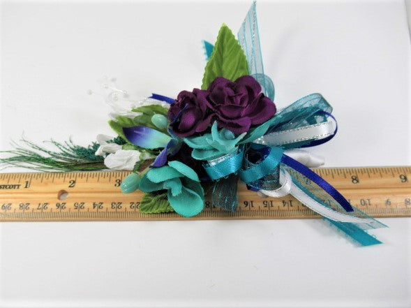 Men's Pin On Boutonniere with Peacock Sword Feather, Aqua Turquoise Orchids, and Purple Roses - Odyssey Creations