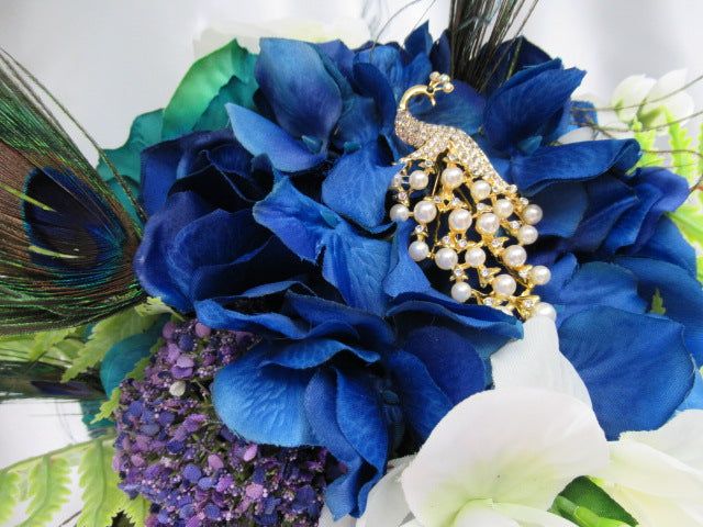 Peacock Cascading Bridal Bouquet and Boutonniere Set in Blue, Purple, Teal, White and Green with White Pearl Peacock Brooch - Odyssey Creations