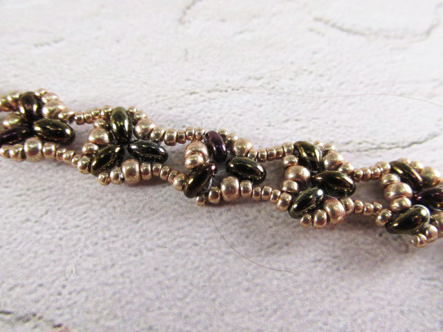 Lacy Victorian Style Green, Plum and Gold Beaded Beadwork Bracelet with Charms - Odyssey Creations