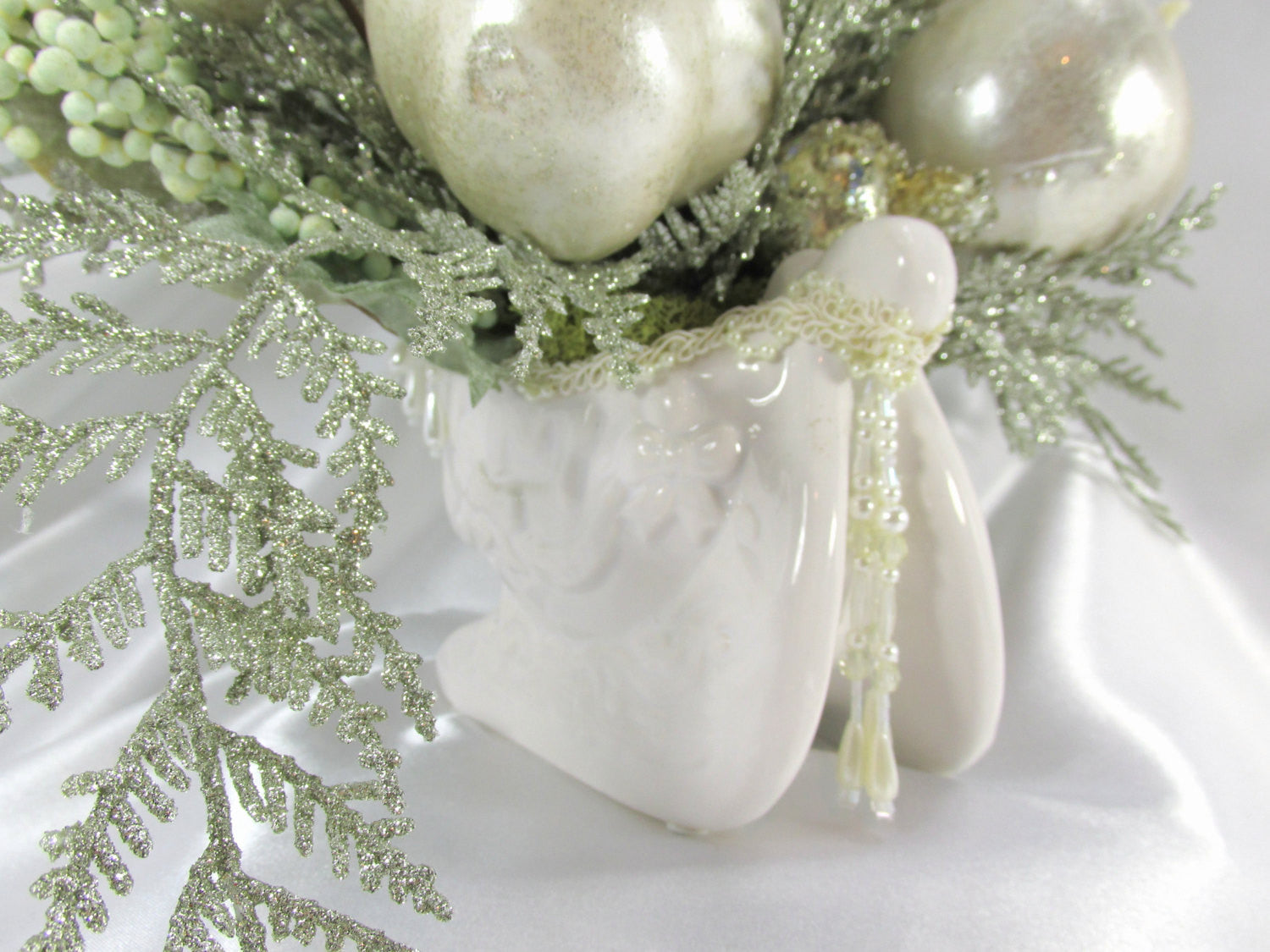 Ivory Magnolia Winter Floral Centerpiece in Porcelain Sleigh with Mint Green and Ivory Pearl Accents - Odyssey Creations