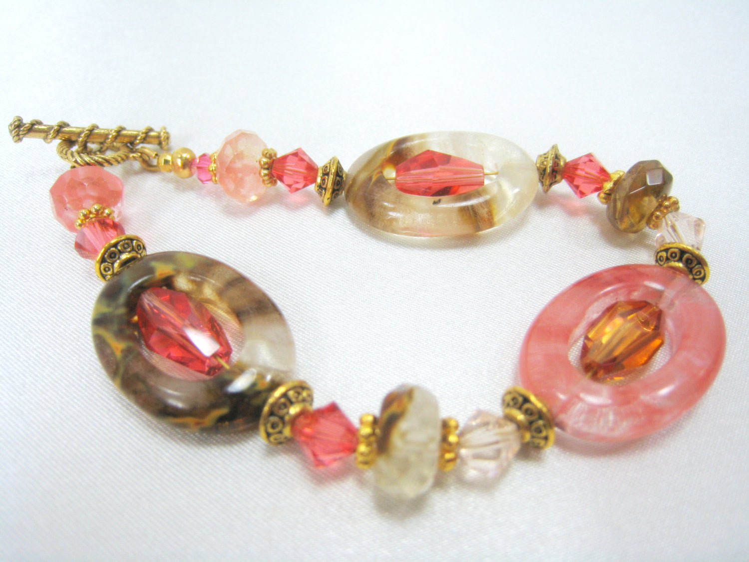 Desert Rose Coral, Brown, Ivory Bracelet in Swarovski,  Oval cut Quartz Glass, and Faceted Quartz on Gold - Odyssey Creations