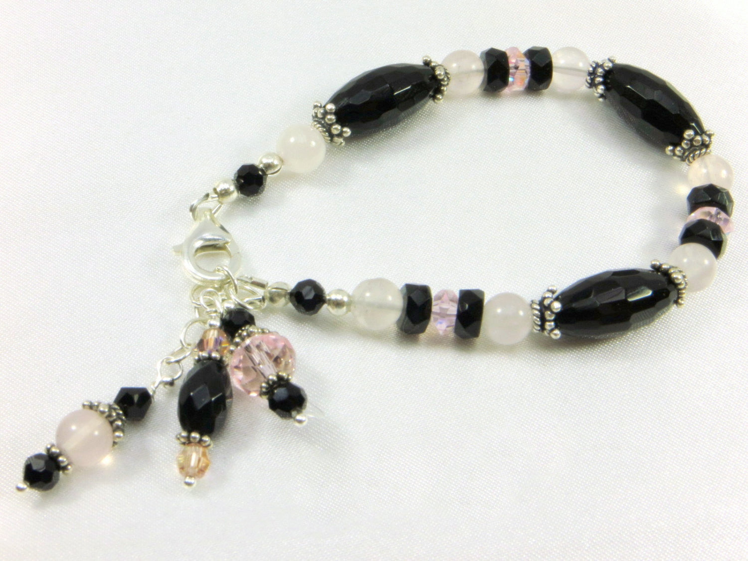 SALE - Pink Rose Quartz and Black Onyx Semiprecious Ston on all Sterling Silver Bracelet with charms - Odyssey Creations